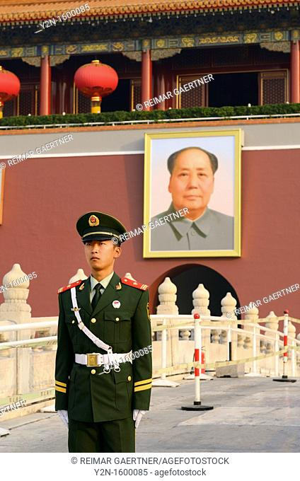Peoples Armed Police guard with portrait of Mao Zedong at Tiananmen Gate of Heavenly Peace Beijing China