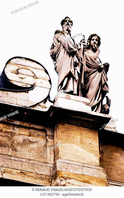 Statues above Sorbonne University entrance doorway. Paris. France