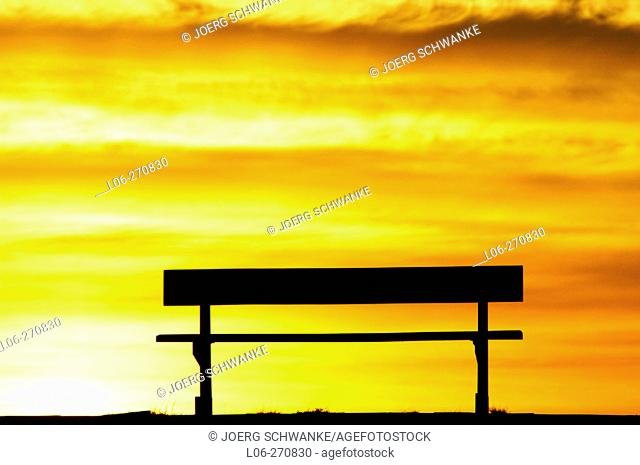 Bench against sunrise
