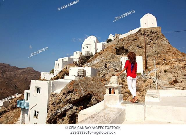 Woman looking up to the churches in Hora, Serifos, Cyclades Islands, Greek Islands, Greece, Europe