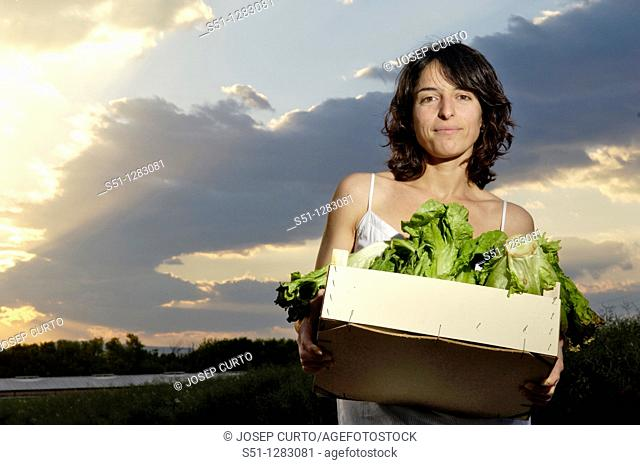farmer with a box of lettuce