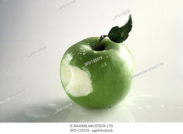 A Granny Smith Apple That Has Been Bitten, Water Drops