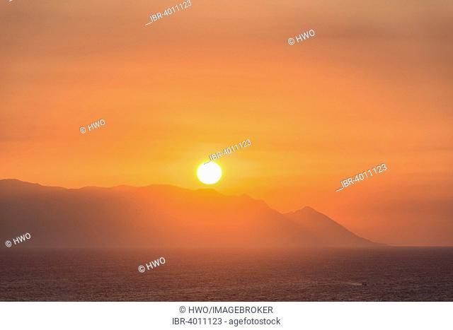 Sunset on the Greek island of Samos, Ionian coast, Aegean Region, Türkmen Mh., Kusadasi, Aydin province, Turkey