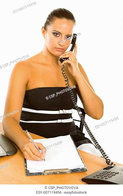 Young businesswoman holding a telephone working