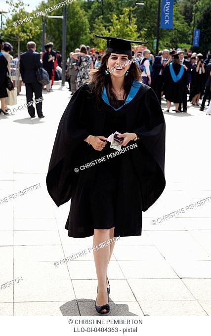Happy student on graduation day, Warwick University, England
