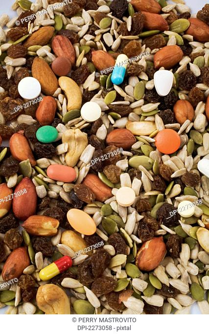Dried fruit and nuts mixed with medicine pills