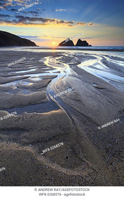 Sunset captured in March from the beach at Holywell Bay on the North Coast of Cornwall. The image was carefully composed to make the most of the pool's of water...