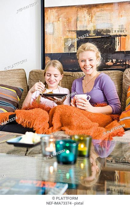 Mother and daughter in a couch, Sweden