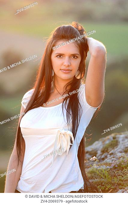 Portrait of a good looking young lady in nature, Bavaria, Germany