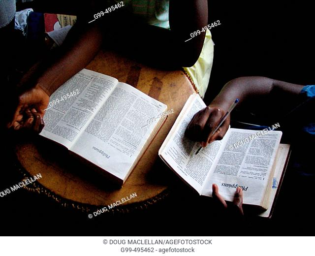 Children at the Kampala School for the Physically Handicapped, Uganda read bibles during Sunday school