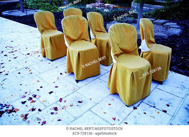 Seats outdoors in the evening