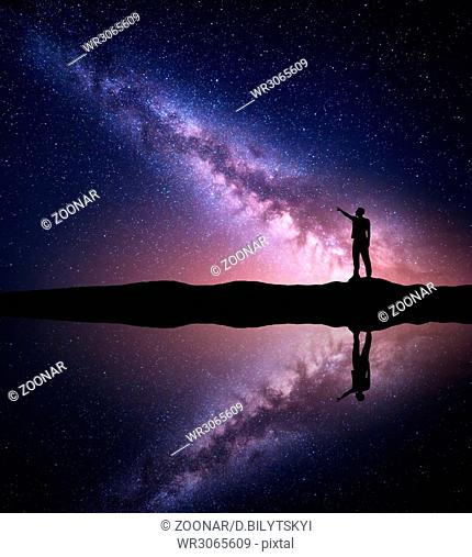 Milky Way. Silhouette of a standing man near the river