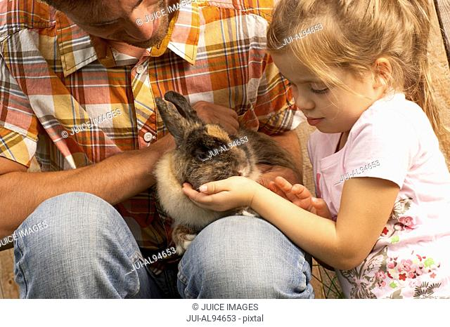 Father and daughter with bunny rabbit