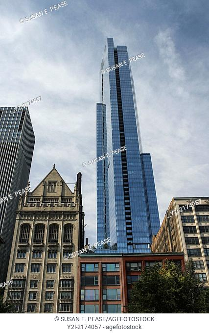 The University Club (left, completed in 1908) and the Legacy at Millennium Park (glass skyscraper completed in 2008.) Chicago, Illinois