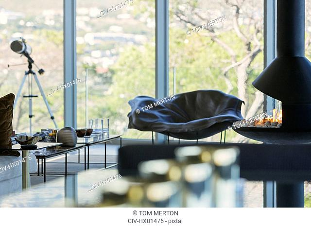 Telescope and fireplace in luxury home showcase living room