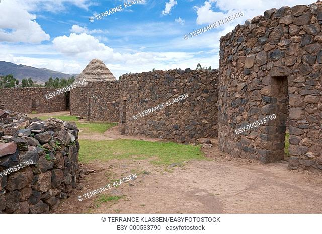 Homes and storehouses in the archeolgical ruins of the Temple of Wiracocha in Racchi, Peru, South America