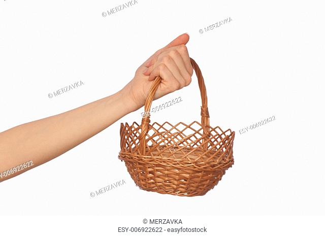 one brown empty basket for fruit on woman's hand