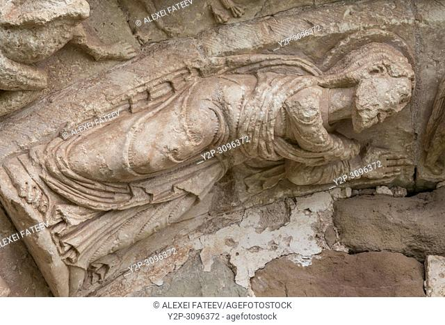 St. John the Baptist. Detail of portal of Romanesque church San Andrés (12th century) in Soto de Bureba, province Burgos, Castile and Leon, Spain