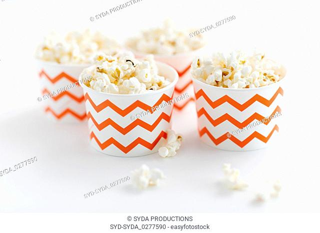 close up of popcorn in disposable paper cups