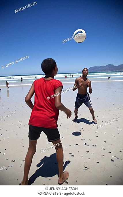 Local boys playing football on the beach, Muizenberg
