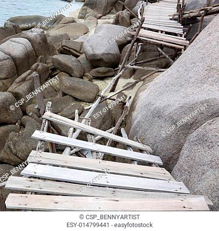 old damage wooden bridge by the sea nang yuan island