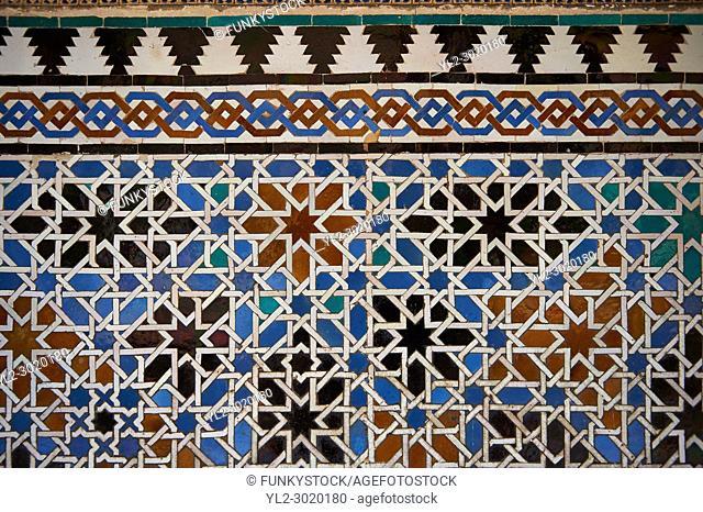 Arabesque Zellighe tiles with Mudjar plasterwork of the Alcazar of Seville, Seville, Spain