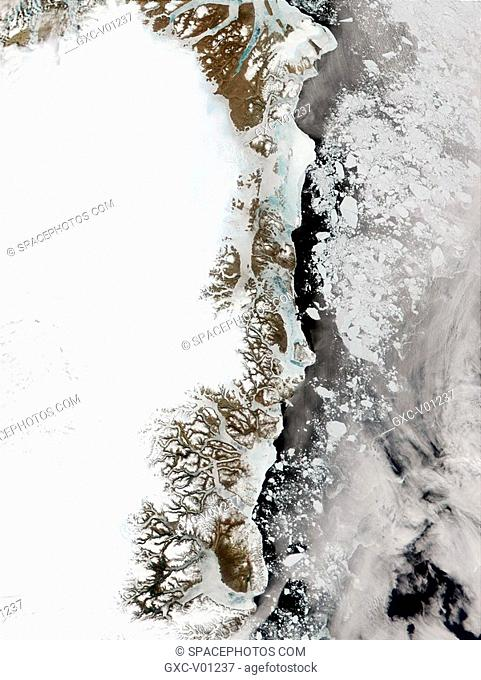 Through the clouds, ice-free water can be seen in this true-color image of the eastern Greenland coast