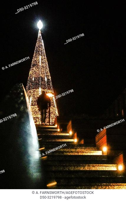 Gdansk, Poland A man walks up the steps to giant illuminated Christmas tree in the Old Town