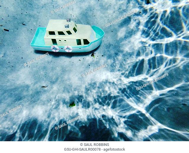 Plastic Toy Boat at Bottom of Swimming Pool