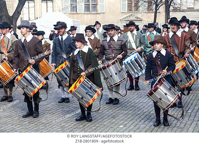 Fife and Drum band marching through Old Town Geneva during Escalade celebrations