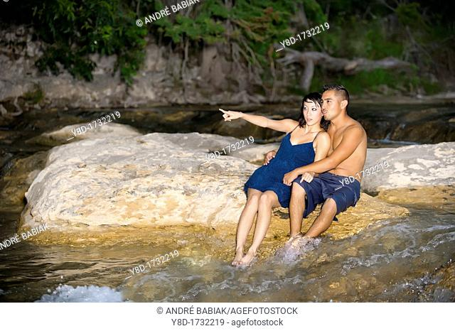 Young couple in love - Asian woman, 20 years old, Korean Ethnicity, hispanic man, 22 years old, location Frio River near Leakey, Texas, USA