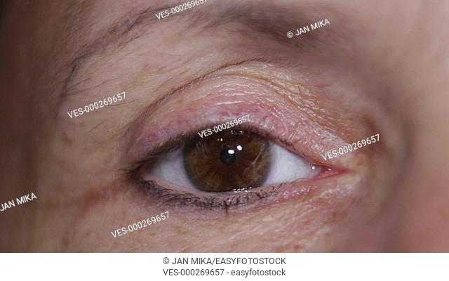 Macro of sleepy eye of middle aged female