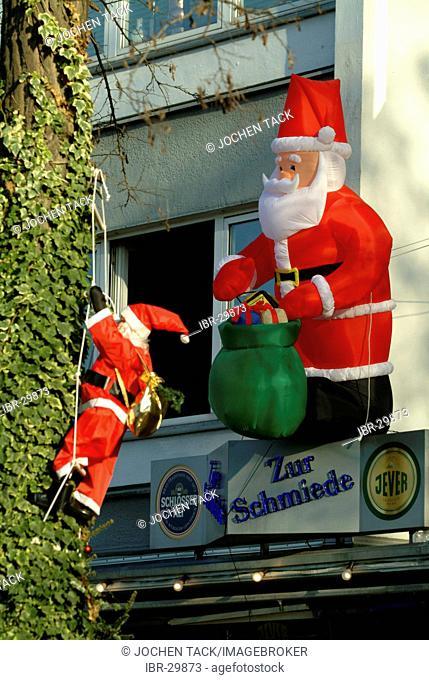 DEU, Germany, Duesseldorf: Chrismas decoration, climbing Santa Claus