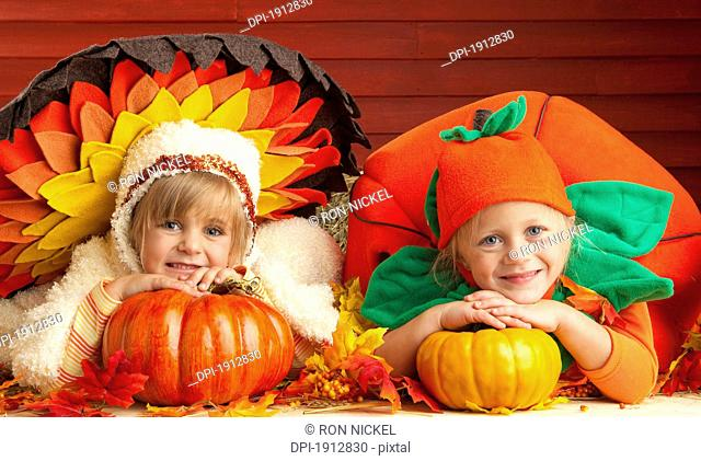 two children wearing turkey and tomato costumes, three hills, alberta, canada