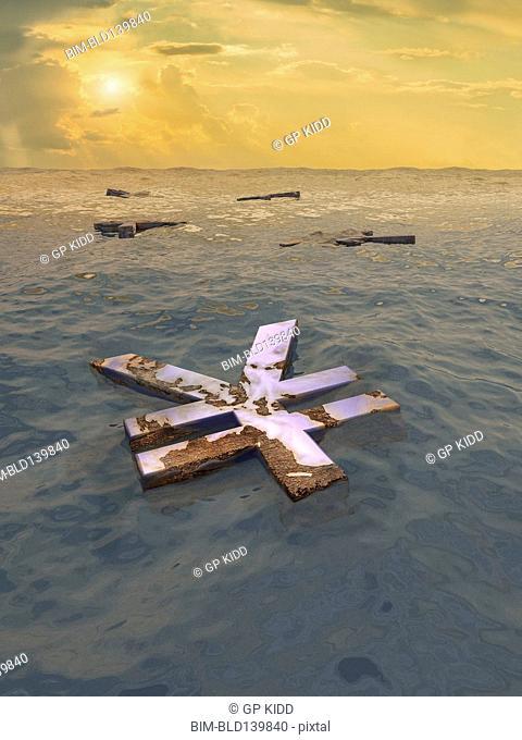 Yuan symbol floating in ocean