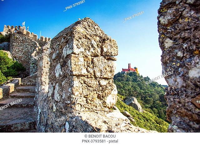 View of Pena National Palace, through the wall of the Moorish Castle, Sintra, Lisbon area, Portugal