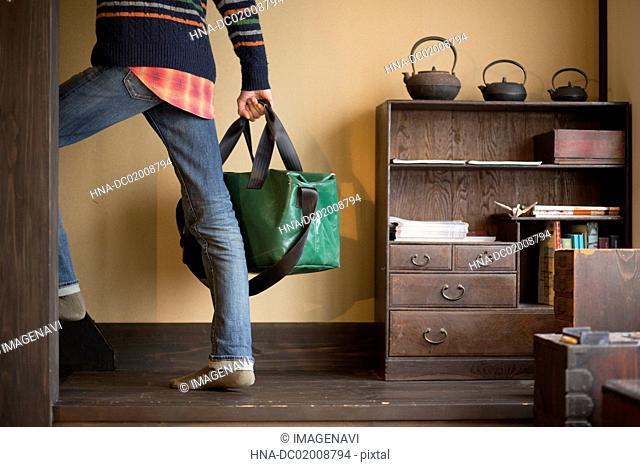 Traveler holding baggage