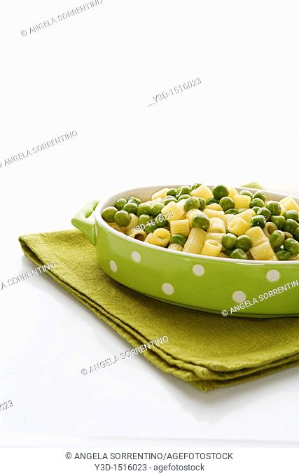 Plate of pasta with green peas