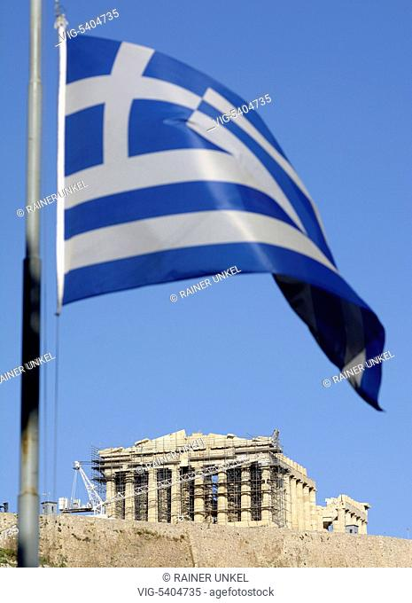 GRC , GREECE : A greek flag is fluttering near the Acropolis in Athens , the main temple is the Parthenon , 06.02.2016 - Athens, Attica, Greece, 06/02/2016