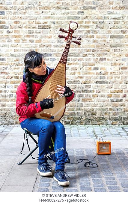 England, London, Southwark, Bankside, Female Chinese Busker Playing Chinese Lute