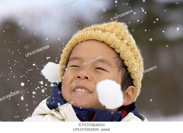 Boy playing with snow