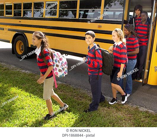 students getting off the school bus