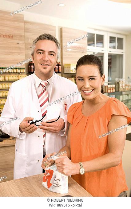 Customer In Pharmacy, Munich, Bavaria, Germany