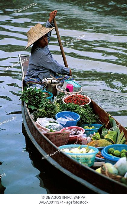 A Thai woman, floating market, Bangkok, Thailand