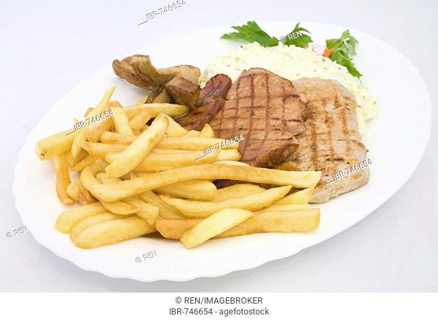 Grilled cutlets served with coleslaw and french fries