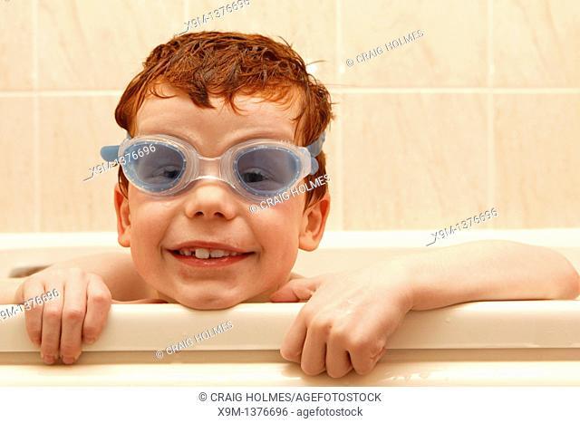 Bath time  Boy wearing goggles in the bath