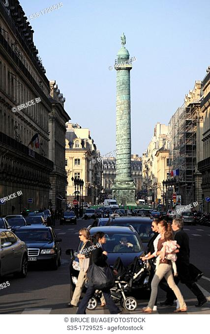 The view of Vendome Column in the center of Place Vendome seen from Rue de la Paix with pedestrian in foreground  Paris  France