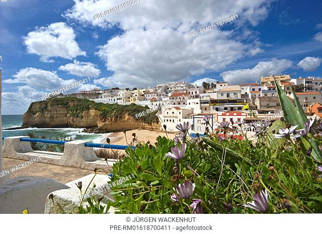 View of Carvoeiro village with beach and rocky coast, Algarve, Portugal, Europe