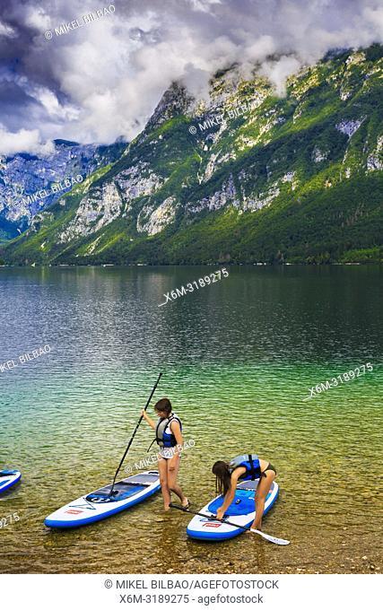 Paddle surf. Lake Bohinj. Bohinj. Triglav National Park. Upper Carniola region. Slovenia, Europe