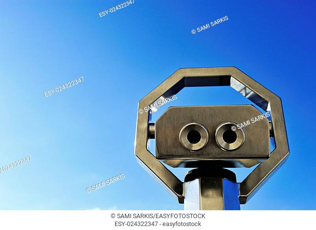 Binoculars or telescope looking up at a clear blue sky